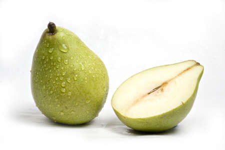 Fruits,one full and one half cut green pear with water droplets on white background