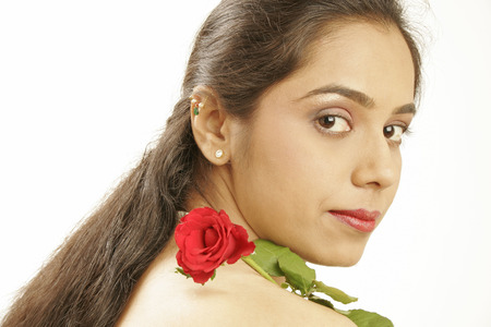 South Asian Indian teenage girl holding red rose Stock Photo
