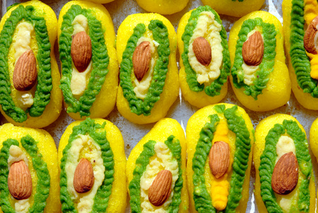 Sweet dish,Bengal sweet cham cham multi color circle made by mava and malai