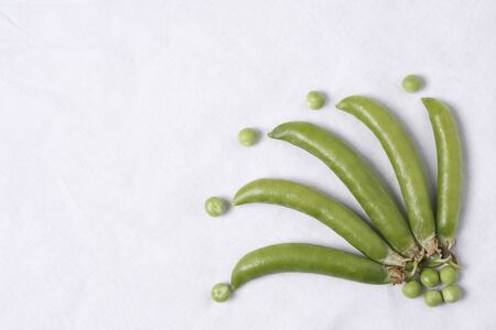 Vegetable,Green Pea pods Pisum sativum with unpeel peas on white background