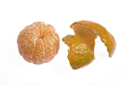 Fruits,peeled off juicy orange and peel on white background