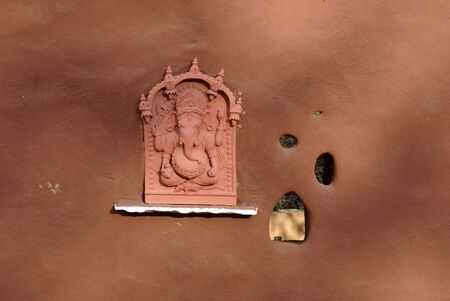 figurines: Terracotta Ganesh statue on wall at Shilpgram,Udaipur,Rajasthan,India LANG_EVOIMAGES
