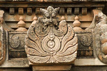 Decorated kirtimukh on Krishna temple pinnacle,Hampi,Karnataka,India Stock Photo