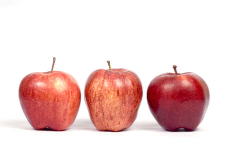 Fruits,three red apples in single row on white background