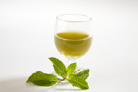 Green spices mint juice against white background,pudina ka rus,India Stok Fotoğraf - 85787160