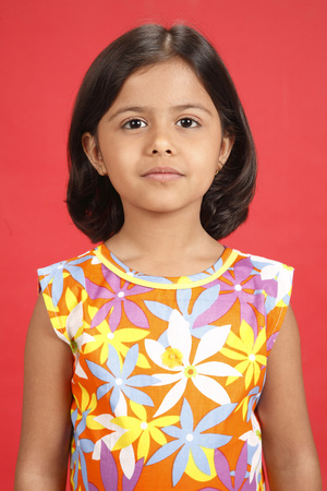 Eight year old girl looking at camera
