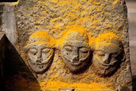 Statues immersed in turmeric powder at the  Jejuri temple,Pune,Maharashtra,India Stock Photo