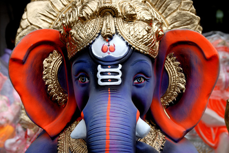 figurines: Close up face of lord Ganesh ganpati idol LANG_EVOIMAGES