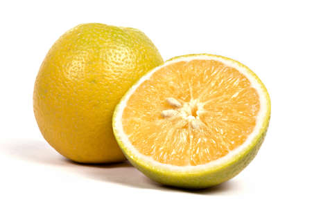 Fruits,one full and one half cut inside golden and outside yellow color sweet lime on white background