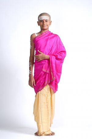 dhoti: South Asian Indian bald boy in dhoti wearing pink cloth tilak on forehead  LANG_EVOIMAGES