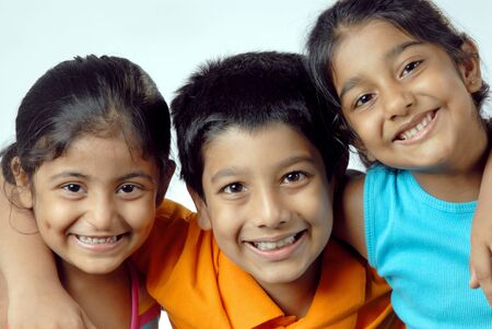 Group of South Asian Indian girls with boy smiling together Stockfoto