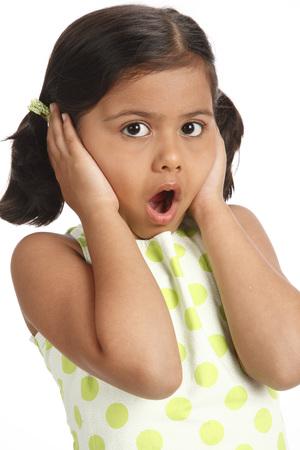 Eight year old girl kept both hands on both ears