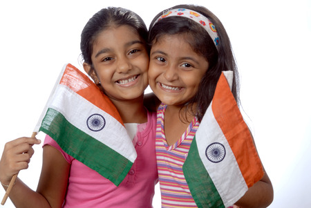 South Asian Indian girls holding flag of India showing mischievous naughty expression Stock Photo