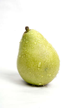Fruits,one green pear with water droplets on white background Stock Photo