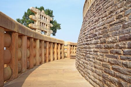emperor ashoka: Passage encircling with railings stupa 1 with western gateway in background,Sanchi near Bhopal,Madhya Pradesh,India LANG_EVOIMAGES