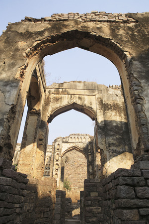 Golconda fort built by Mohammed Quli Qutb Shah 16th century view of ruined walls multiple arches,Hyderabad,Andhra Pradesh,India