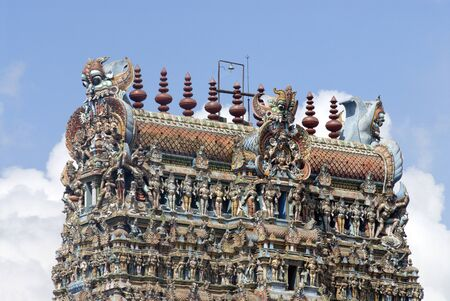 Richly decorated and Colourfully painted stucco figures on  gopuram of Shree Meenakshi Sundareswara temple,Madurai,Tamil Nadu,India Stock Photo