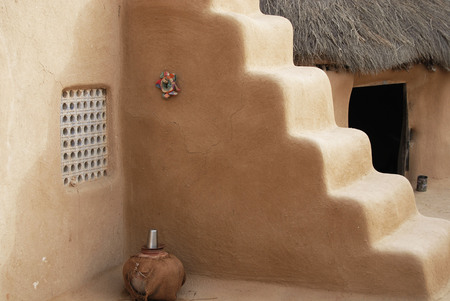 Hut made of cow dung in village near Bikaner,Rajasthan,India LANG_EVOIMAGES