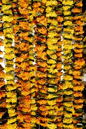 toran: Flower with mango leaves garlands zandu orange color flower
