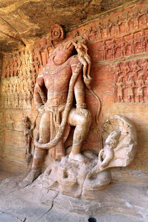incarnation: Cave cut into sandstone hill 5 kms from vidish gupta shrines no 5 showing Vishnu in boar incarnation topped with frieze of gods,Udaygiri,Bhopal,Madhya Pradesh,India