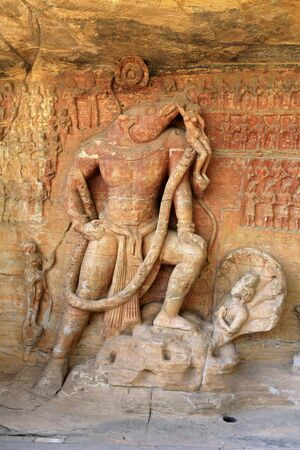 figurines: Cave cut into sandstone hill 5 kms from vidish gupta shrines no 5 showing Vishnu in boar incarnation topped with frieze of gods,Udaygiri,Bhopal,Madhya Pradesh,India