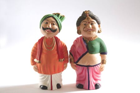 dhoti: Concept,atut bandhan showpiece of clay or mud man and woman gift item LANG_EVOIMAGES