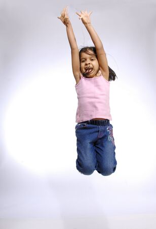 South Asian Indian girl enjoying freedom jumping in air