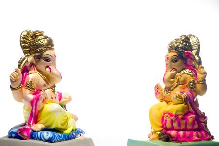 Celebration of Ganesh Chaturthi Elephant headed god one clay Idols on white background