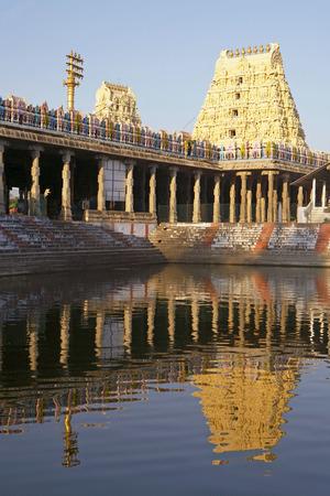 Gopuram reflecting in pond of Ekambareswarar temple of Shiva built by Pallava king,Kanchipuram,Tamil Nadu,India Stock Photo