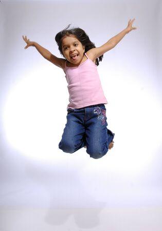 South Asian Indian girl enjoying freedom jumping in air
