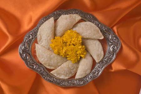Karanji a sweet cake-like stuffed eatable during Diwali deepawali festival,India Stock Photo