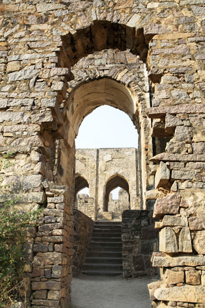 Golconda fort built by Mohammed Quli Qutb Shah 16th century view of inside hall with broken columns and arches,Hyderabad,Andhra Pradesh,India