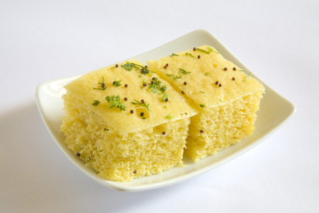 spongy: Indian cuisine,fast food Dhokla served in dish on white background LANG_EVOIMAGES