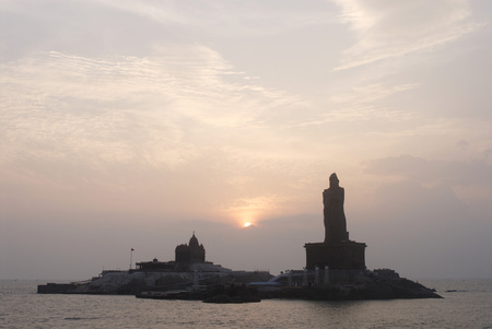 Sunrise behind Swami Vivekananda Rock Memorial and Thiruvalluvar statue immortal poet,Kanyakumari,Tamil Nadu,India