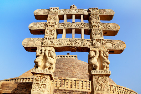 emperor ashoka: West gateway of stupa 1 front view with architraves supported by pot-bellied dwarfs and interesting scenes at site Sanchi near Bhopal,Madhya Pradesh,India