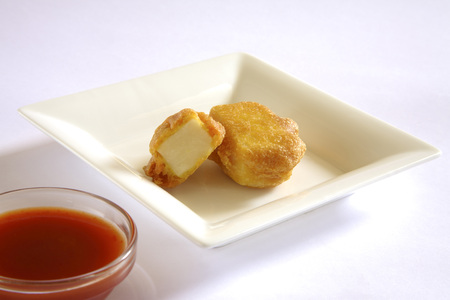 spongy: Indian cuisine,fast food starters Cheese Pakode puffs served with tomato ketchup in dish on white background LANG_EVOIMAGES