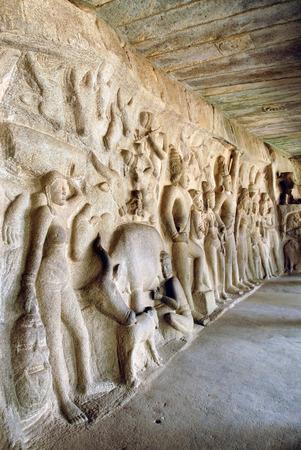 pallava: Huge bas-relief in hall mandapa of Krishna lifting Govardhana hill,Mahabalipuram,Tamil Nadu,India LANG_EVOIMAGES