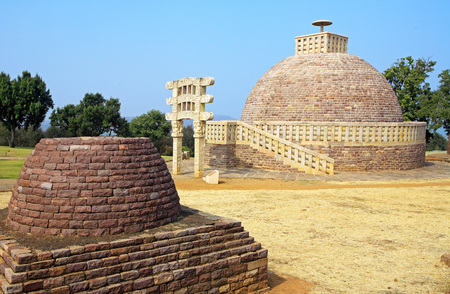 emperor ashoka: Stupa 3 wall encircling and stapes to go-up with gateway and similar in design with smaller stupa in foreground,Sanchi,Bhopal,Madhya Pradesh,India