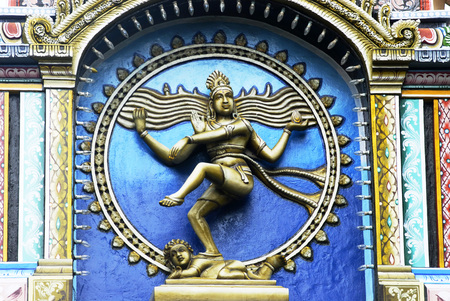 Nataraja lord Shiva performing Tandava cosmic dance colourfully painted stucco work on facade of Nataraja Hall,Thanjavur palace,Thanjavur,Tamil Nadu,India