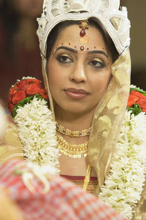 Bengali bride in traditional bridal get up in Indian Hindu wedding ceremony