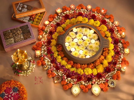 Diyas and flowers arrangement for Diwali festival of lights