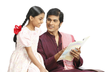 Rich Indian farmer teaching book lesson to daughter