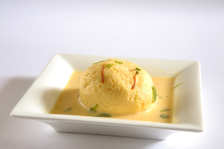 Indian sweet,kesar rasmalai garnish with pistachio and saffron served in plate