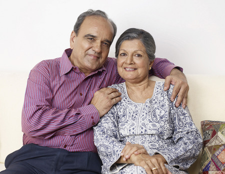 Old couple embracing Stock Photo