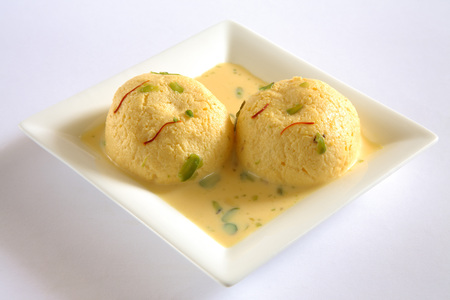 spongy: Indian sweet,kesar rasmalai garnish with pistachio and saffron served in plate