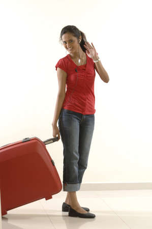 College going young girl going out of country for higher studies with her suitcase