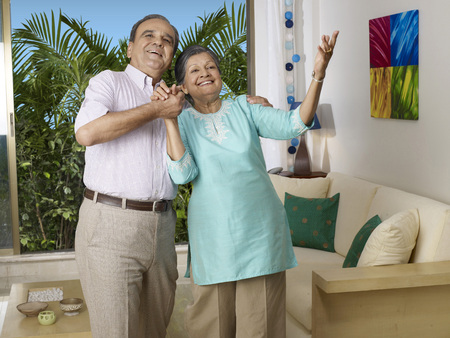 Old couple in dancing pose and singing