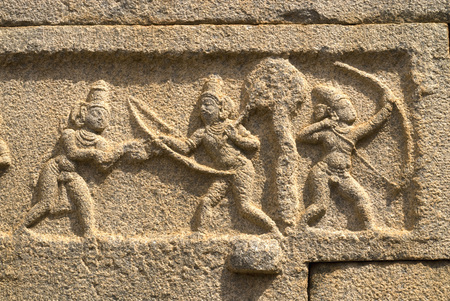 Rama and Lakshmana sculptures on outer wall of Ramachandra temple in Hampi,Karnataka,India