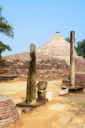 emperor ashoka: Stupa 3 stands northeast of main stupa 1 similar design smaller one gateway with broken pillars and smaller stupa in foreground,Sanchi near Bhopal,Madhya Pradesh,India