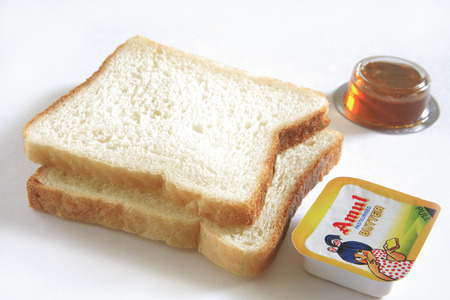 Breakfast,bread butter and honey on white background Stock Photo